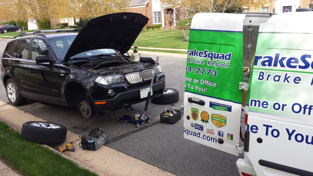 Brake Squad Tech Looking Under the Hood of a Car | TheBrakeSquad.com