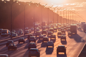A Freeway at Sunset That is Heavily Congested by Traffic